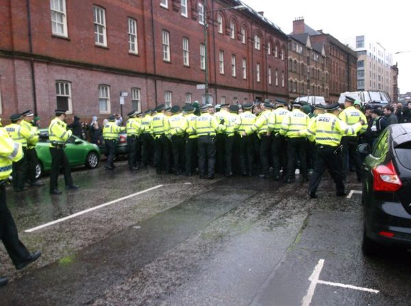 A police line attempts to stop the march minutes after it begins (Picture courtesy of TCN)