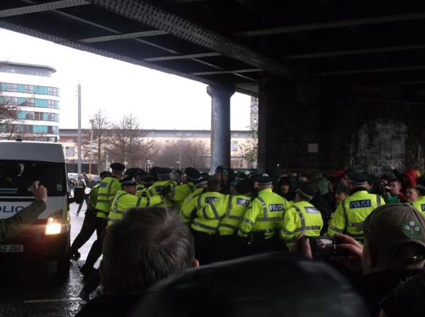 Marchers broke through the attempted police blockade underneath the bridge at Bell Street (Picture courtesy of TCN)